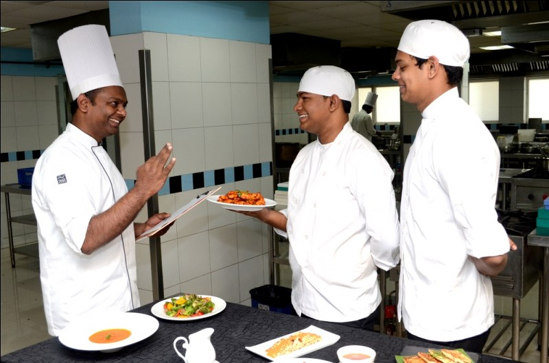 Chef taking test of students